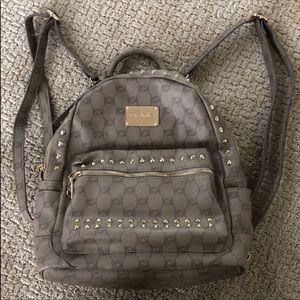 Bebe Gold stud embellished backpack purse